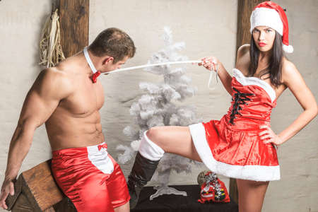 sex santa: Snow Maid and her boy with stick in interior with bdsm devices