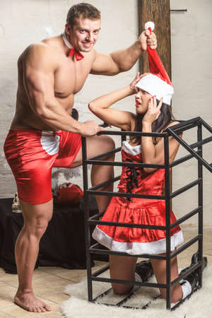 snow man party: Snow Maiden with her boyfriend are playing with steel cage Stock Photo