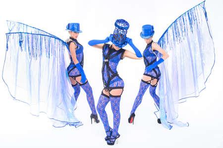 perfomance: Dancing women trio in blue dresses. Studio perfomance.