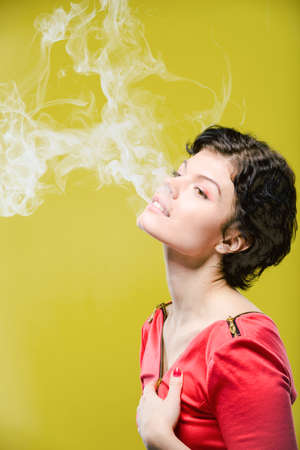 smoking girl: Smoking girl on colored background. Natural unretouched image. Stock Photo