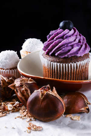 Still life with capcake, chestnuts and flakes
