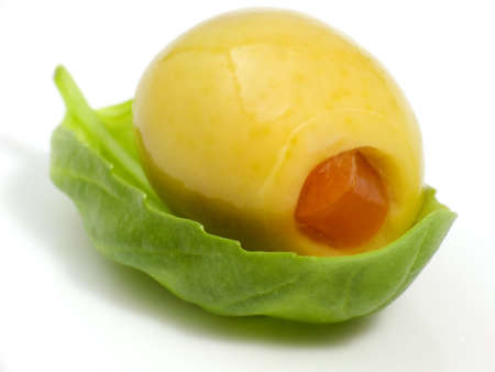 nutricion: Macroshot of an olive on a leaf of basil Stock Photo