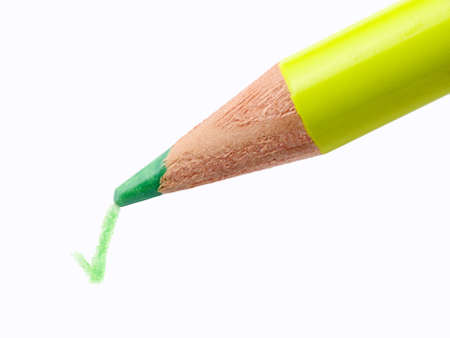 Pencil writing a green check mark on a white sheet of paper without shadow photo