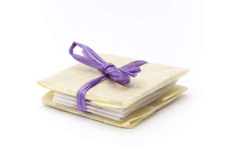 A small book tied with a purple ribbon like a present photo