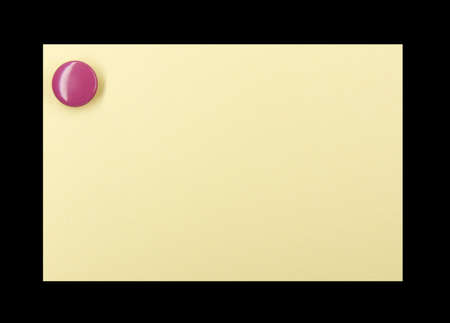 Purple pushpin holding up a yellow note on a black background photo