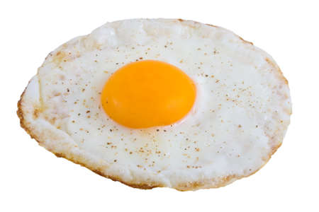 Closeup of Fried Egg isolated over white background photo