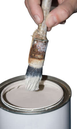 Paint can, brush and hand on a white background photo