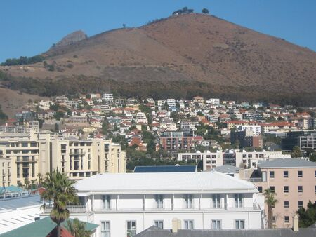 arial views: Mountain Seen Behind Small Suburb of Cape Town Stock Photo