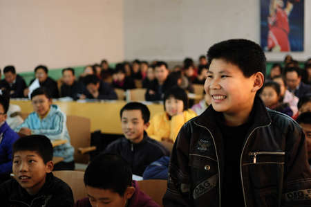 answered: In a classroom lesson, a male student answered confidently questions from teachers. November 10, 2010, Xingtai City, Hebei Province, China. Editorial