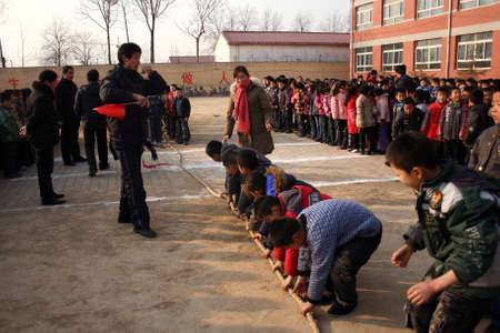 In the primary school tug of war, the small players are very involved, and the scene is very moving. December 14, 2010, Xingtai City, Hebei Province, China. Stock Photo - 15902689