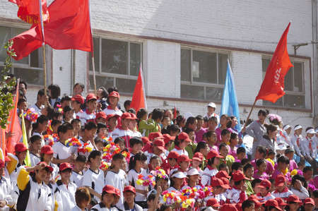 Meeting in the student movement, the game is very exciting. In the stands, cheering enthusiastically audience. Xingtai City, Hebei Province, China, May 12, 2011.