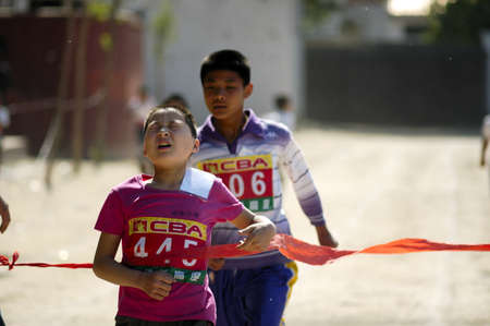 tenacity: In the student movement, students are to demonstrate the tenacity of will and fighting spirit. This photo is a wonderful sprinter crossing the finish line when the shot. Xingtai City, Hebei Province, China, May 12, 2011.