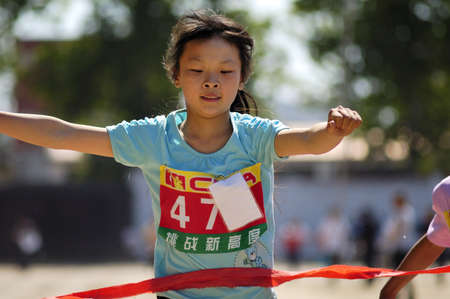 In the student movement, students are to demonstrate the tenacity of will and fighting spirit. This photo is a wonderful sprinter crossing the finish line when the shot. Xingtai City, Hebei Province, China, May 12, 2011.