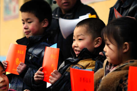 The school held a commendation meeting, presented the award\ certificates and prizes to the outstanding achievements of\ students.The picture shows the the prizes scene, award-winning\ students are very happy and proud!Xingtai City, Hebei Province,\ China, Ma