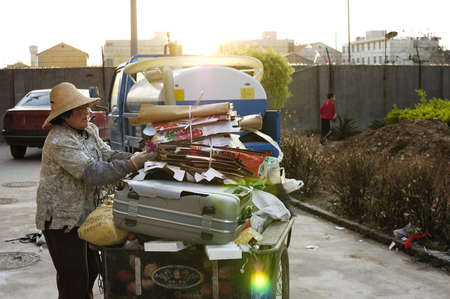 Cities in China, there are many such cleaners, they do not have a formal organization or company.They travel frequently to the residential area garbage or old items.Xingtai City, Hebei Province, China, May 5, 2010. Stock Photo - 16070142