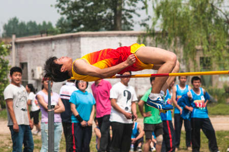 strive for: Baixiang County, Hebei Province, China, May 14, 2013. Student Games  jump competition venues, athletes strive first, to strive for the best results.