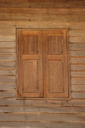 Wooden window in a house built of wood Stock Photo - 18334293