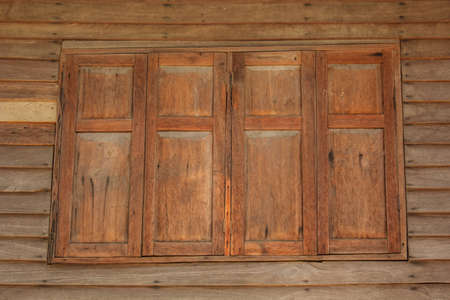 Double wooden window in a house built of wood Stock Photo
