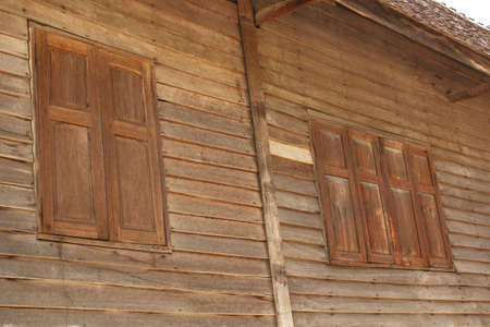 Wooden windows in a house built of wood Stock Photo - 18347381