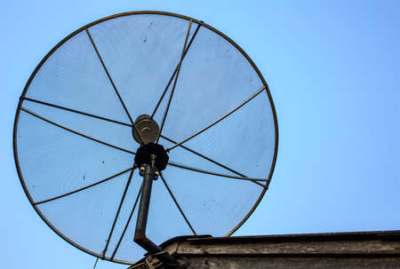 cohere: Satellite dish on the roof with a blue sky