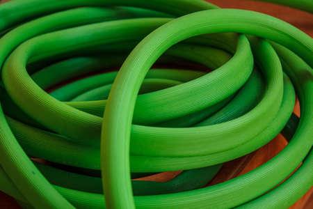 Green hose reel on tile. Stock Photo - 18593950