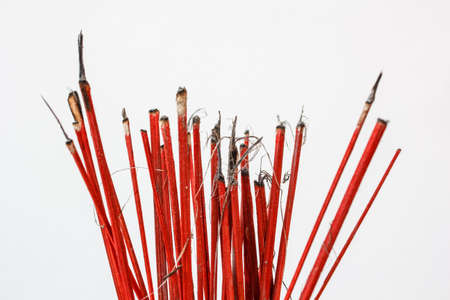 Red sticks pay homage to a Buddha image Stock Photo - 18593882