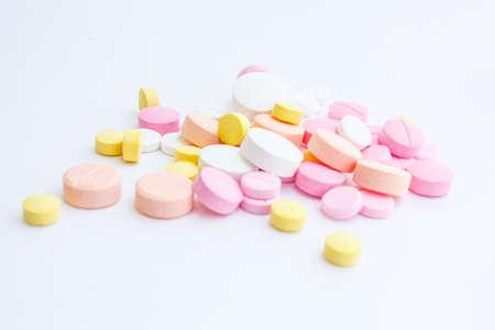 Drug pouring out of medicine bottle