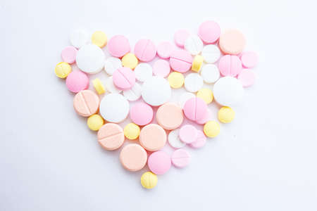 Drugs that are arranged in a heart shape Stock Photo