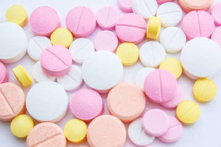 enrich: Drug pouring out of medicine bottle