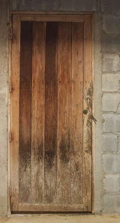 Old wooden door at the kitchen door Stock Photo