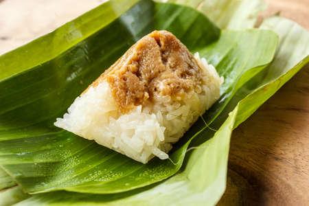 Rice custard on a banana leaf Stock Photo