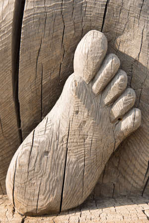 close - up of feet carved from wood Stock Photo