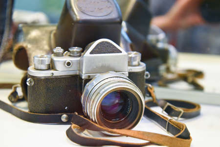 Vintage camera in leather case, with leather strap, vintage, Museum.