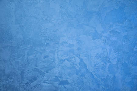 Frozen window patterns. Blue background. Abstraction. Frost
