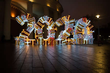 Street Christmas decoration figures 2020. Light digits of large size. street decoration for the new year and Christmas. Digits are composed of garlands and tinsel. Stock fotó
