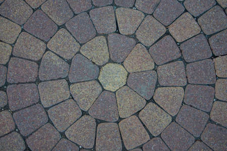 Sidewalk tiles laid out from the center. The circular walls. Flower, the shape of the sun.
