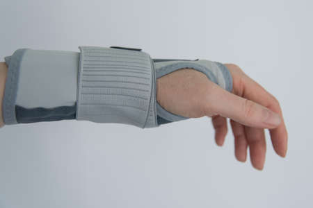 Female hand with orthosis, recovery and treatment with modern orthosis.