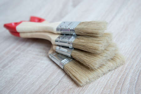 New paint brushes of different sizes. The concept of choice