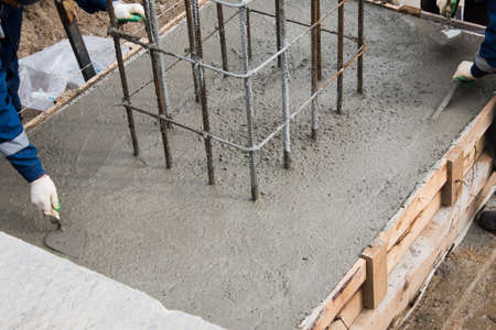 The process of compacting and smoothing fresh concrete. Concrete is poured into the formwork with rebar.