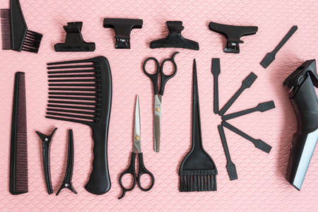 Barber accessories, laid out on a pink background. Postcard