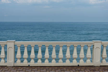 View from the embankment to the sea. Railing. The base for the postcard 版權商用圖片