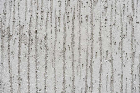 Concrete wall with a pattern. Geometry. Background