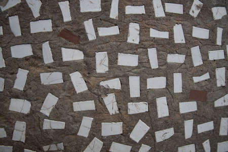 Background of concrete and pieces of ceramic tiles. Texture, background. Zdjęcie Seryjne