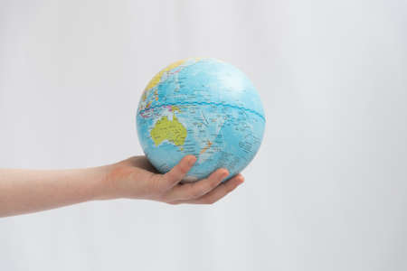 Childrens hands carefully hold the globe. Concept. Our land is in the hands of the future generation Stok Fotoğraf