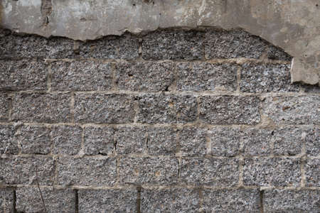 The texture of the old wall from a cement block. Rough gray surface. Concrete structure