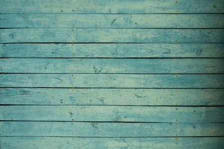 Background of an old wooden fence in turquoise or green. Pastel delicate shade. The texture of the painted old wood Stok Fotoğraf