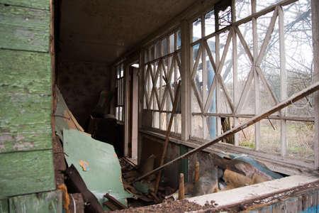 An old abandoned house with broken windows. Destruction concept. Broken glass and mess Stok Fotoğraf