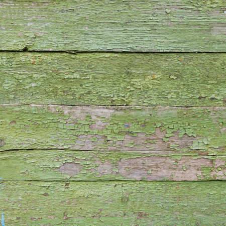 Old boards, background texture. Green paint. horizontal boards with old paint