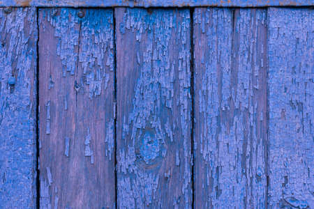 Boards of delicate blue and pink shades. The texture of a wooden fence. Background, texture