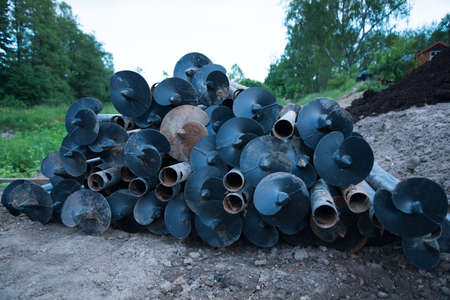 Metal piles for construction. The piles are piled up, ready to go Stok Fotoğraf